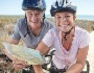 9449-Couple_Mountain_Biking_Smiling