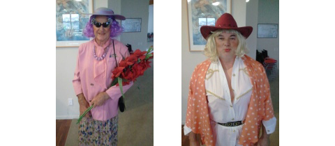 9919 Village Manager and a Resident Dressed as Dame Edna  Left  and Dolly Parton  Right