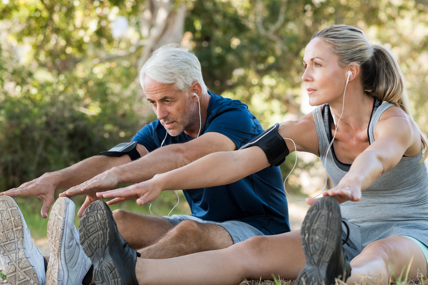 Couple stretching at park