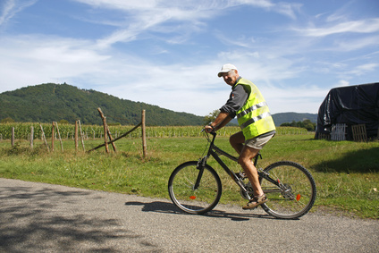 Male cyclist enjoying a ride in reflective safety clothes