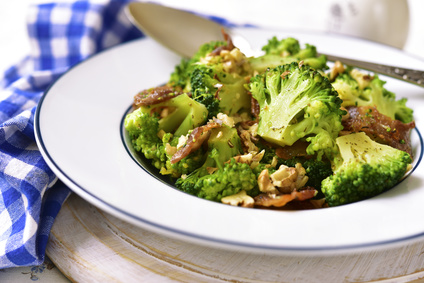 Broccoli with fried bacon and walnuts in vintage style.