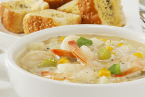 Chowder - with shrimp or prawns, corn, potatoes and coriander, served with garlic bread.