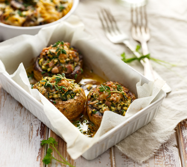 Stuffed mushrooms in a casserole dish