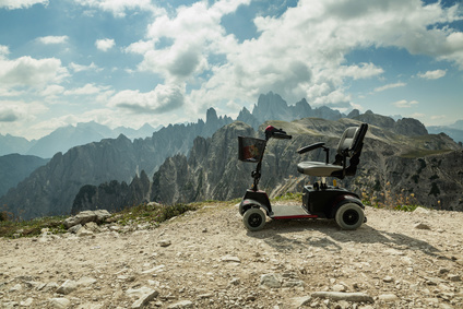 motorised wheelchair for disposable people, Mobile electric buggies on the mountain, Dolomites, Italy. disable car