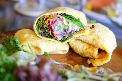 Omelette rolls with salad, cut in half