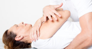 physiotherapy doctor applying a body manipulation on a female patient