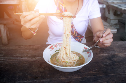 Thailand Noodle soup with pork and chilli on wooden table