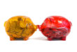two kissed piggybanks orange and red