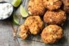 Fritters with carrots, sweet potato and feta cheese, served with yogurt and lime.