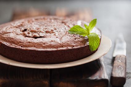 Chocolate cake brownie on gray background, closeup
