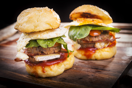 Home made gluten free mini burgers or sliders with beef, egg, lettuce, cheese and sauce