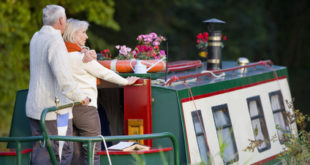 Couple hugging on narrow boat