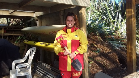 Taimania Hinds of the Trust Waikato Hot Water Beach life guard service is ready to hire you a spade.