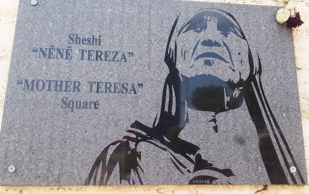 The large plaque in Mother Teresa Square Tirane. Note the floral tribute top right corner. 1