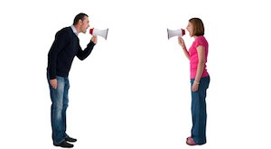 man and woman arguing using megaphone bullhorn isolated on white