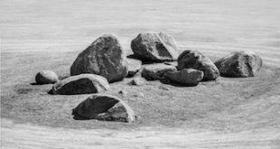 black and white photo of group of heavy stone for zen garden underconstruction  under sunlight in daytime