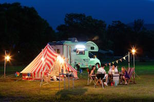Group of friend having party in a camping site at