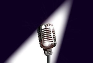 A microphone ready on stage for the performer