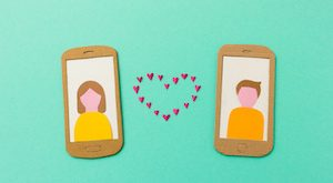 Internet love - Online dating concept with girl and boy falling in love via smartphone