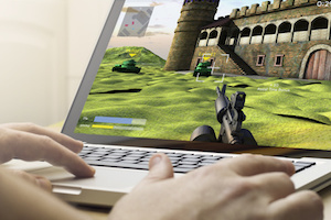 gaming concept: man using a laptop to play war game