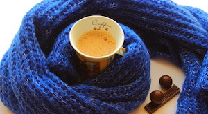 cup of coffee and chocolate in a scarf and chocolates candies