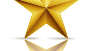 golden star on white with reflection