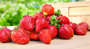 juicy sweet strawberry on a wooden table in garden