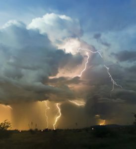 A Chaotic Cumulonimbus Thundercloud with Lightning Strikes Within It at Twilight