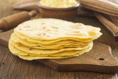 Homemade tortilla on a wooden board.