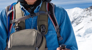 Active senior man hiking in the snowy mountains